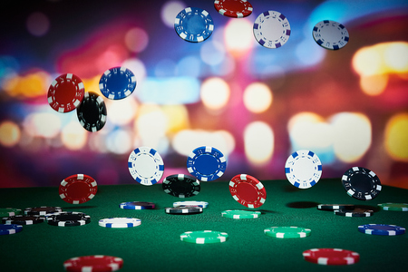 leisure game: Poker chips on table in casino