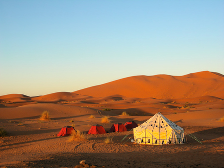 Tent in the desert with blue sky