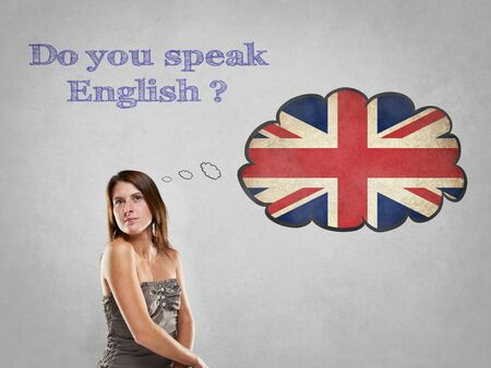 international students: Girl with flag say Do you speak English Stock Photo
