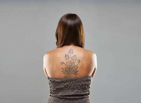 punk hair: Tattoo woman portrait in studio shoot on grey background Stock Photo