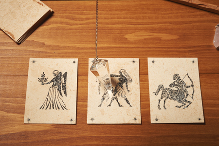 clairvoyance: Clairvoyance card with crystal pendulum on table