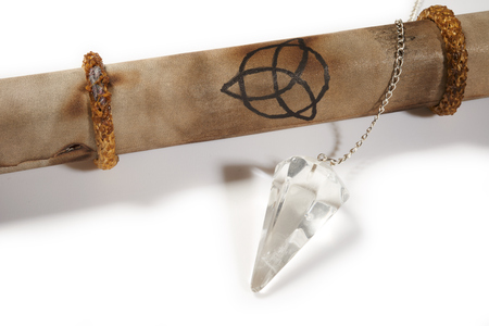 dowsing: Old parchment with crystal pendulum for divination