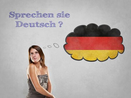 ドイツ語を話すことを言ってフラグを持つ少女 写真素材