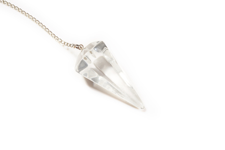 dowsing: White crystal pendulum for divination isolated on white background Stock Photo