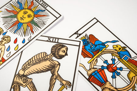psychic: Tarot cards for divination with death on white table