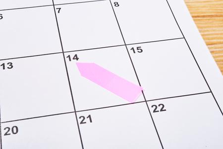 ピンクの付箋と議題のバレンタインデー 写真素材