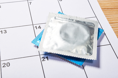 safe sex: Condom protection for Valentine Day on calendar