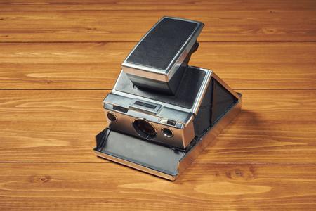 Old polaroid camera on table