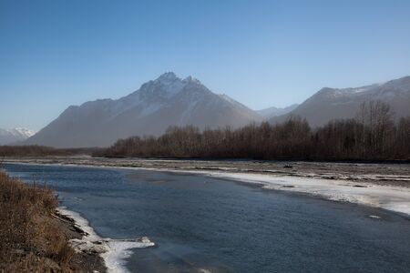 descends: Early freeze-up descends on river in remote region of Alaska  Stock Photo