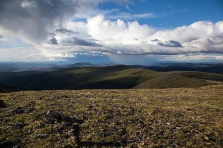 alpine tundra: Rain storms hang over the high alpine tundra