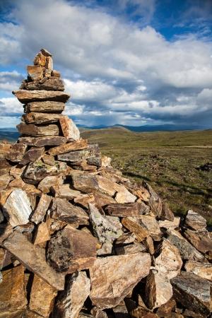alpine tundra: Rock cairn overlooking high alpine tundra Stock Photo