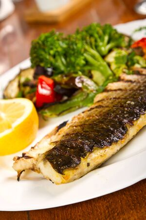 Grilled fish with grilled vegetables photo