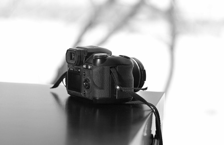 Old bridge dslr camera on a table photo