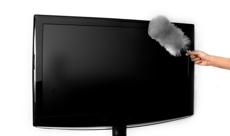 dusting: Person dusting the television set