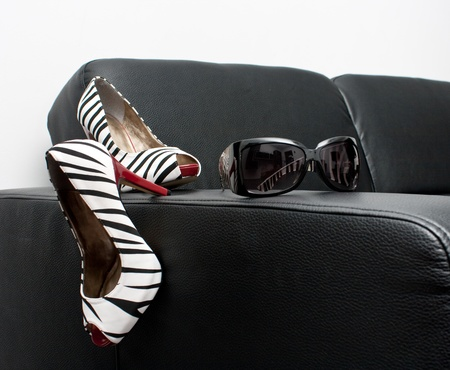 Womans sexy shoes and assorted sunglasses photo