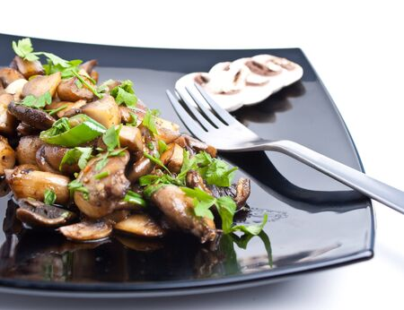 Mushrooms fried in butter with garlic and green hot pepper photo