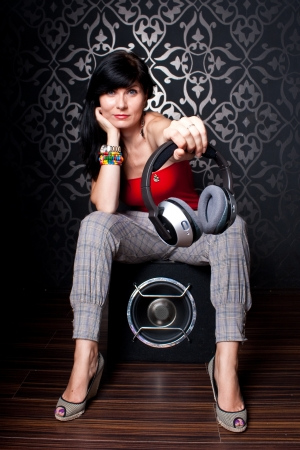 Female model posing as a DJ photo