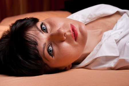 sexual desire: WBeautiful woman laying in the bed Stock Photo