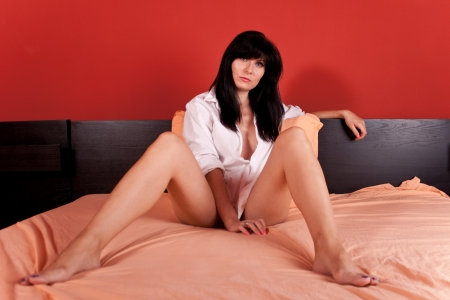 WBeautiful woman laying in the bed Stock Photo - 15033889
