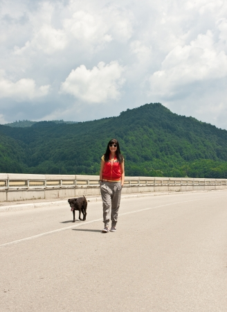 Cool girl walking on a mountain road photo