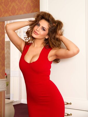 Beautiful woman in a red dress photo