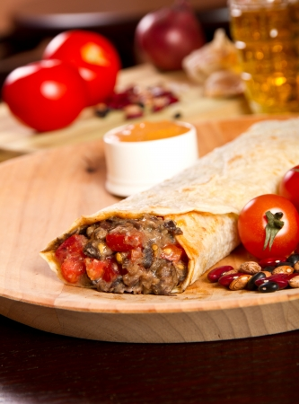 Burrito on a wooden plate photo