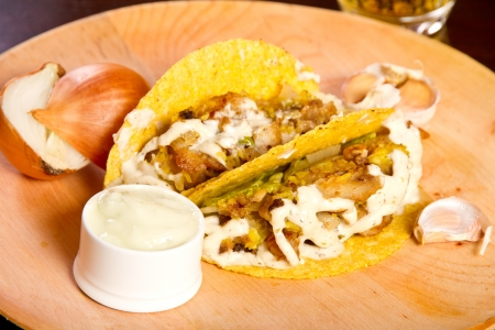 Tacos on a wooden plate photo