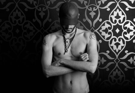 a male model with cap and tattoos photo