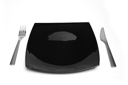 balck: Balck square plate with cutlery aside