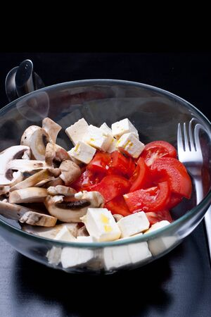 Italian salad with tomatoes, mushrooms and cheese photo
