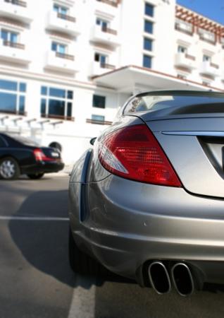 muffler: Luxury sports car in hotel parking lot