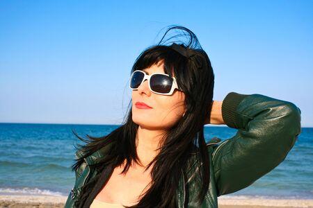 sun bathing: Woman sun bathing on the beach