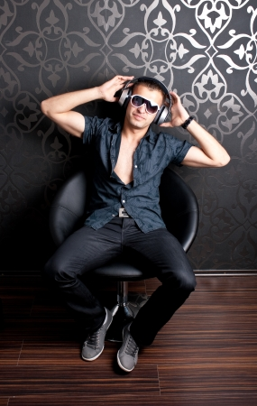 Cool guy sitting on an armchair photo