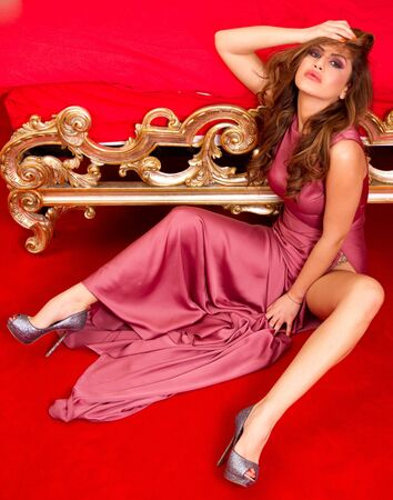 Beautiful model in a purple dress photo