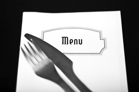 Silverware and a menu on a restaurant table photo