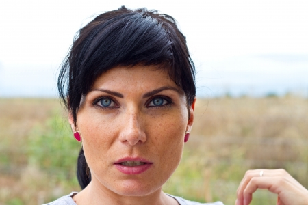 Blue eyed woman looking at the camera Stock Photo