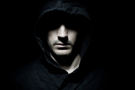 hoodie: Portrait of a male model in the dark Stock Photo
