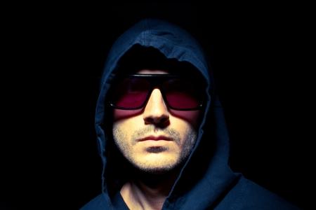 Portrait of a male model in the dark Zdjęcie Seryjne