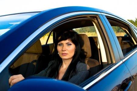Caucasian woman in the driver's seat photo