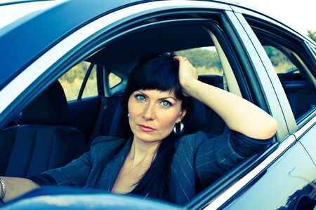 Caucasian woman in the drivers seat photo