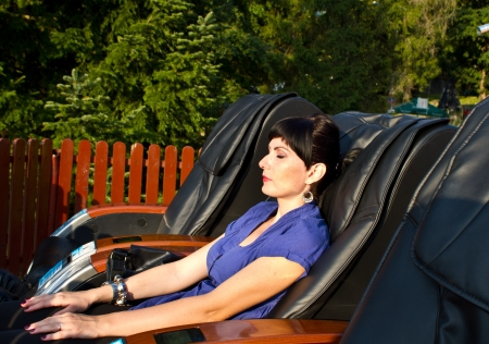 asleep chair: Massage armchairs in nature Stock Photo