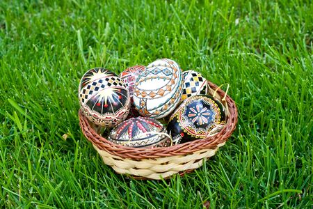Beautifully colored easter eggs in a basket photo