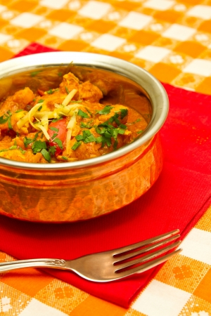 Indian curry in a copper bowl photo