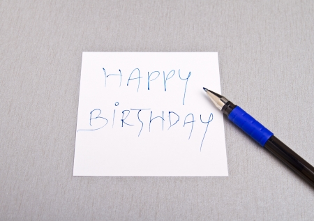 Happy Birtday message written on a white paper Stock Photo - 15409288