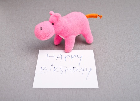 Happy Birtday message written on a white paper Stock Photo - 15409282
