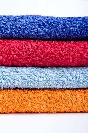 orange washcloth: Colorful towels o white background