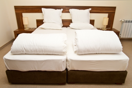 throw cushion: Empty beds in  a bedroom