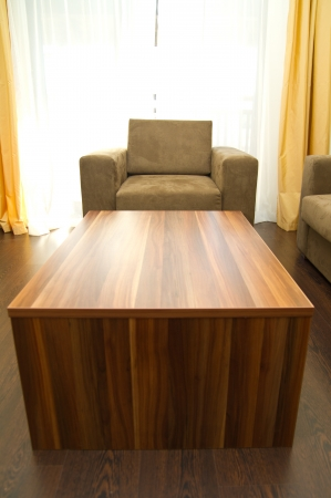 Brown armchair with wooden table in front Stock Photo - 15409278