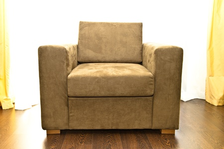 Brown armchair in front of the window Stock Photo - 15409375