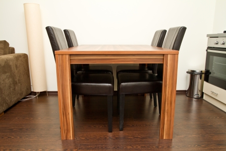 Empty dining table with four seats photo